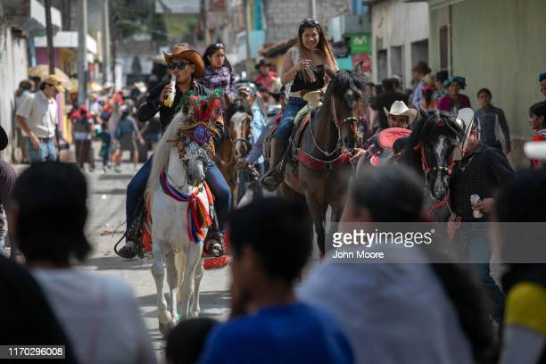 Townspeople take part in the annual Horse Parade on August 25 2019 in Salcaja Guatemala Salcaja located in Guatamala's western highlands is known for...