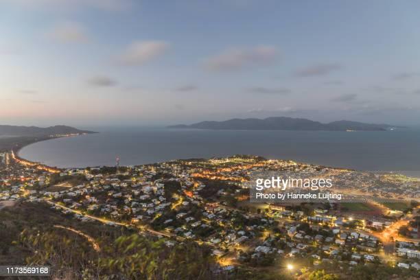 townsville and magnetic island at dusk - クイーンズランド州タウンズビル ストックフォトと画像