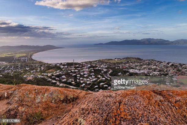townsville cityscape seen from top of mountain with magnetic island visible, townsville, queensland, australia - townsville queensland stock pictures, royalty-free photos & images