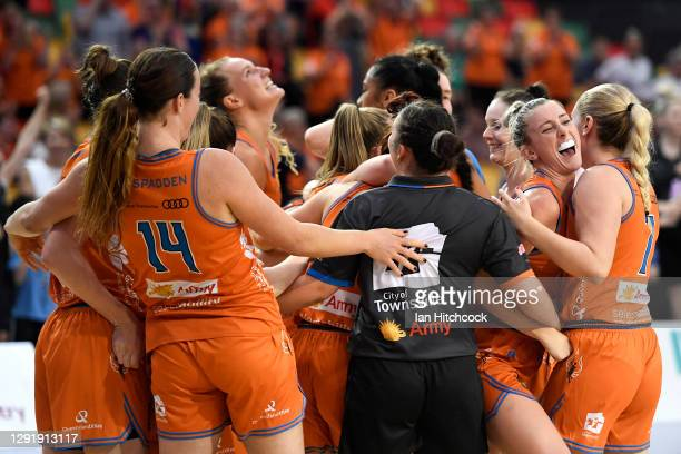 Townsville Fire celebrate after their victory during the WNBL Preliminary Final match between the Townsville Fire and the Melbourne Boomers at...