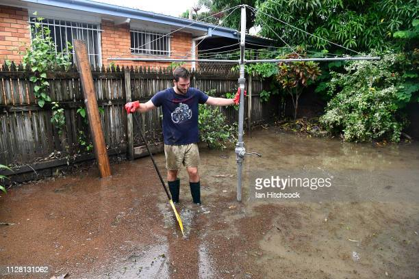 Townsville resident Bryce Horvath stands in floodwater in his backyard in the suburb of Mundingburra on February 08, 2019 in Townsville, Australia....