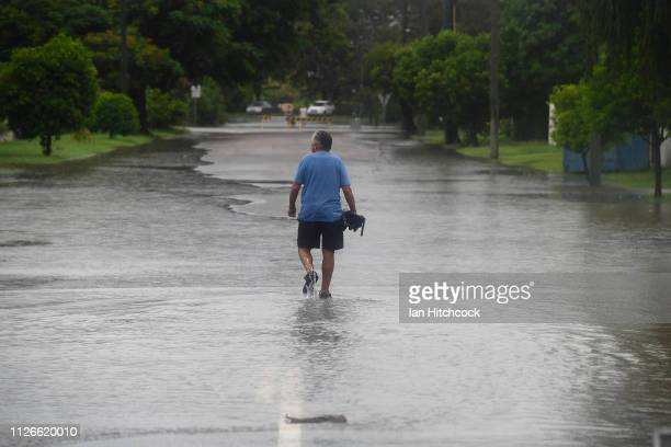 Townsville resident walks through a flooded street in the suburb of Railway Estate on February 01 2019 in Townsville Australia Queensland Premier...