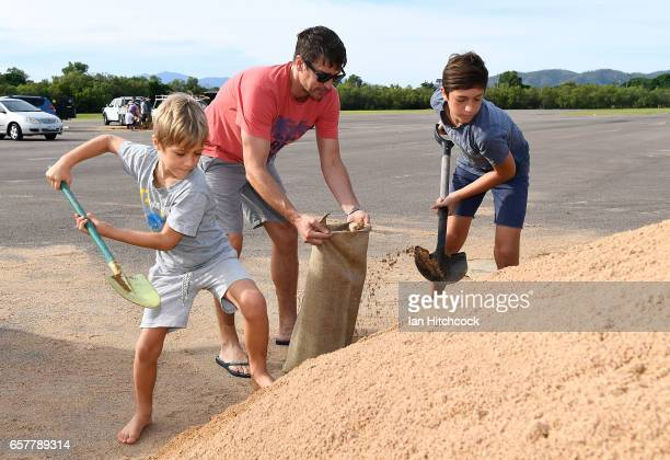 Townsville residents fill sandbags in preparation for Cyclone Debbie on March 26, 2017 in Townsville, Australia. Cyclone Debbie has intensified to a...