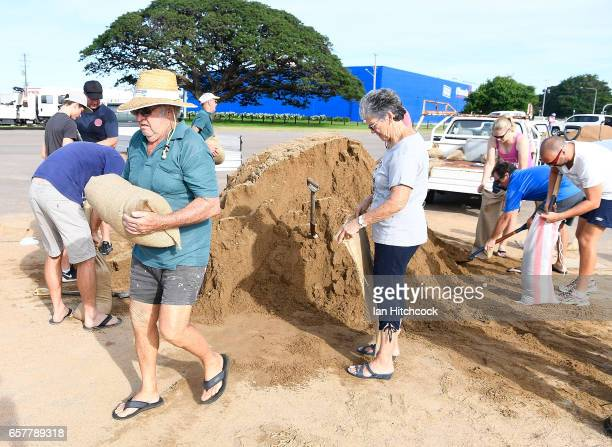 Townsville residents fill sandbags in preparation for Cyclone Debbie on March 26 2017 in Townsville Australia Cyclone Debbie has intensified to a...