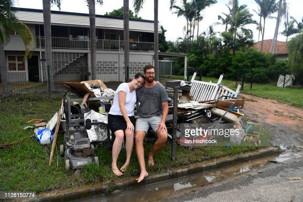 Townsville residents Taneth and Adam Vale pose in their flood damaged home on February 08, 2019 in Townsville, Australia. Residents and authorities...
