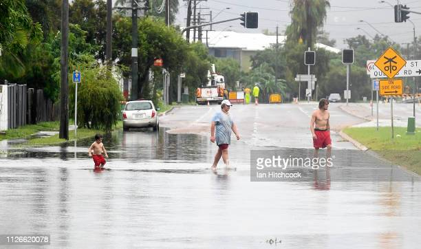Townsville residents walk through a flooded street in the suburb of Railway Estate on February 01 2019 in Townsville Australia Queensland Premier...