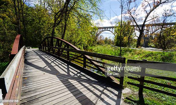 towpath trail bridge in cuyahoga valley national park - cuyahoga river stock photos and pictures