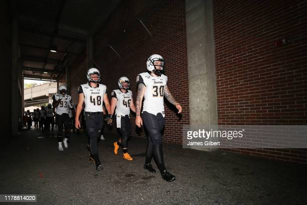 Towson players including Aidan O'Neill Eric Bernstein John Lambert and Conrad Brake exit the locker room before the start of a game against the...
