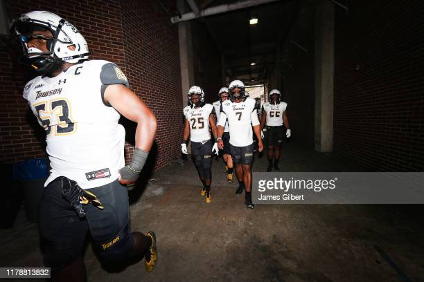 Towson players including Terrill GilletteRodgers Christian Dixon and Bryce Carter exit the locker room before the start of a game against the Florida...