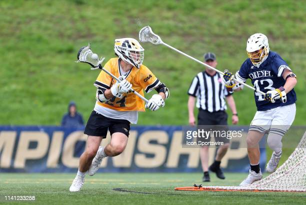 Towson Tigers Brendan Sunday and Drexel Dragons Sean Quinn in action during the CAA Championship game between Drexel Dragons and Towson Tigers on May...