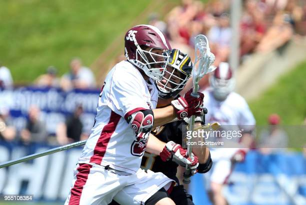 Towson Tigers defenseman Gray Bodden defends UMass Minutemen attackman Buddy Carr during the CAA Lacrosse Championship game between Towson Tigers and...