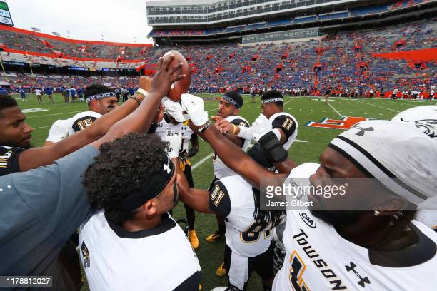 Towson Tigers players meet before the start of a game against the Florida Gators at Ben Hill Griffin Stadium on September 28 2019 in Gainesville...