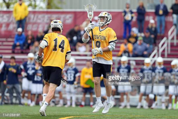 Towson Tigers Zach Goodrich passes to Towson Tigers Casey Wasserman during the CAA Championship game between Drexel Dragons and Towson Tigers on May...