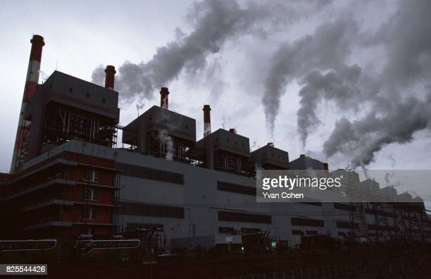 Toxic pollution pours from the huge chimney stacks of the Mae Moh power plant Southeast Asia's largest lignite fired power generating facility...