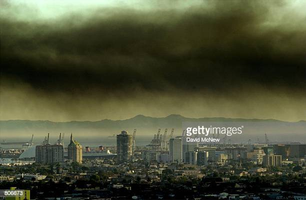 Toxic smoke blows over downtown Long Beach CA April 23 2001 from a fire at the Tosco oil refinery in Carson 15 miles south of Los Angeles The...