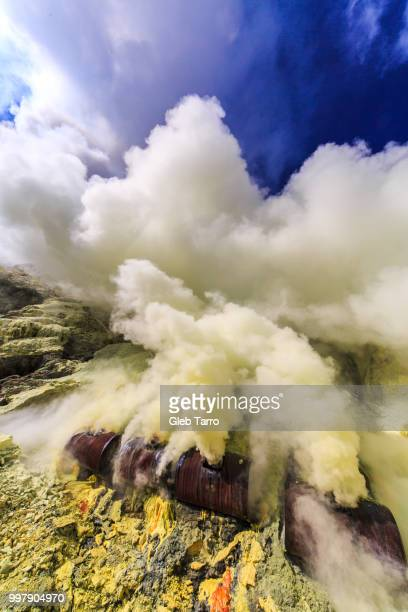 toxic vappors of sulfur mining, mount ijen crater lake, east java, indonesia - east java province stock pictures, royalty-free photos & images