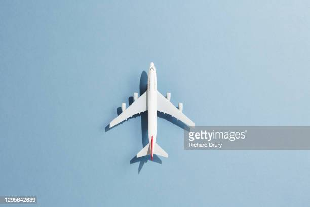 a toy aeroplane against a blue background - richard drury stock pictures, royalty-free photos & images