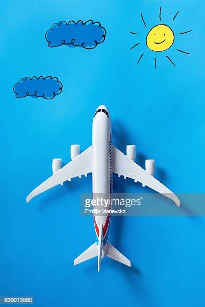 Toy airplane on blue background