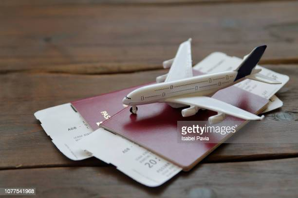 Toy Airplane With Passports and Flight booking ticket. Travel concept.