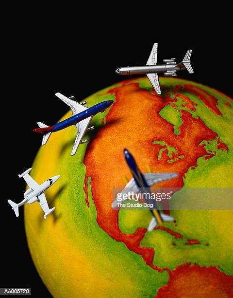 Toy Airplanes Flying Over North America on a Globe