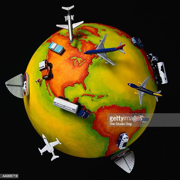 Toy Airplanes, Trucks, Cars and Boats on a Globe