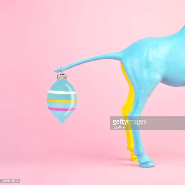 toy animal with shiny ornament on tail - mercury metal stock-fotos und bilder