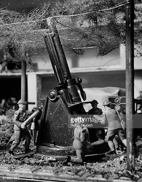 Toy antiaircraft gunners operate on a minature Maginot Line