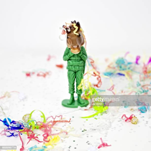 toy army man wearing horse mask - army soldier toy stock pictures, royalty-free photos & images