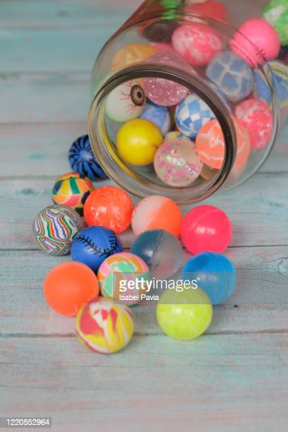 toy balls in glass jar - candy dolls fotografías e imágenes de stock