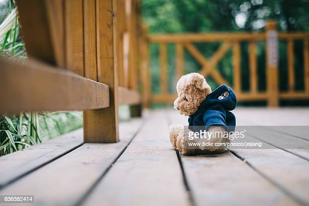 a toy bear is sitting on the floor - blue bear stock photos and pictures