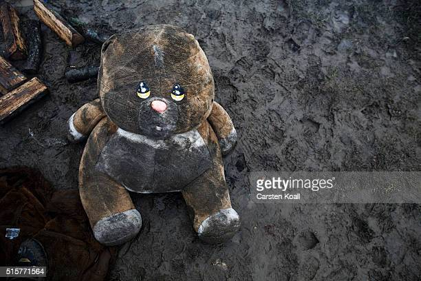 A toy bear lies on the ground in the mud at the Idomeni refugee camp on March 15 2016 in Idomeni Greece The decision by Macedonia to close its border...