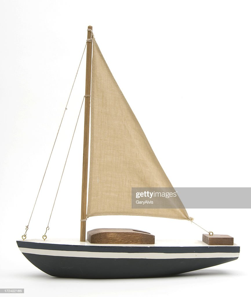 Toy boat with a large brown sail : Stock Photo