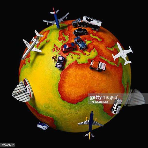Toy Boats, Airplanes, Trucks and Cars on a Globe