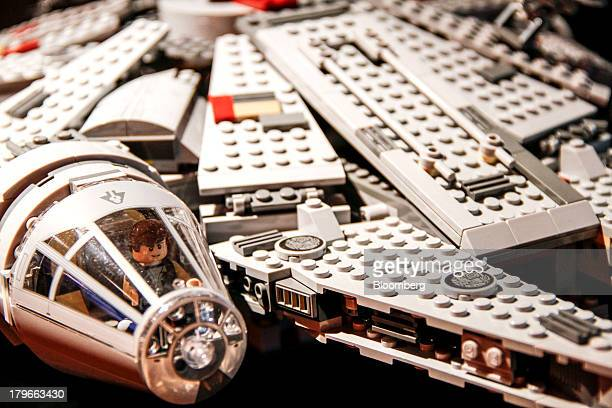 """Toy brick parts for the """"Millennium Falcon"""" model from the Star Wars series sit during assembly at the headquarters of Lego A/S in Billund, Denmark,..."""