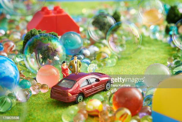 Toy car and figurines with bubbles