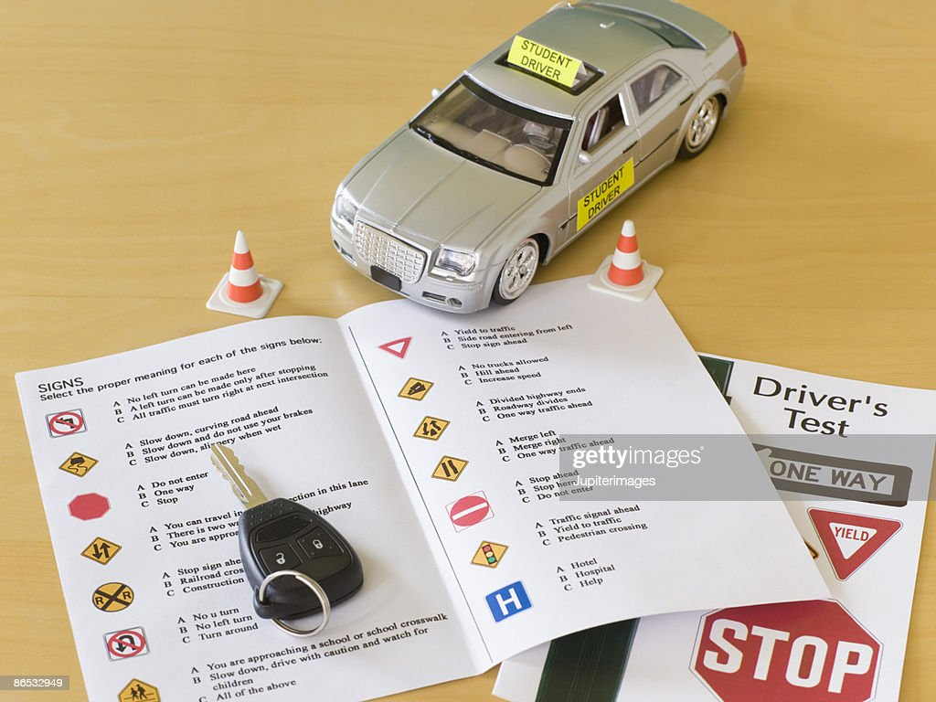 Toy car, car key, and driver's license test : Stock Photo