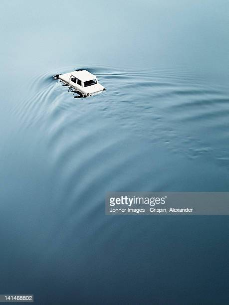 Toy car drowning in water