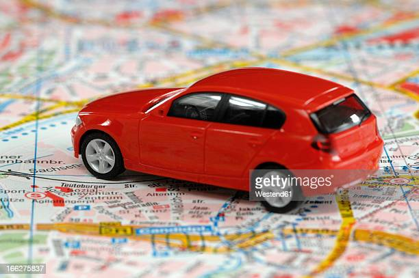 Toy car on city map, close up