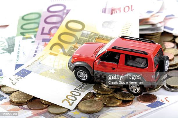 Toy car on Euro notes and coins