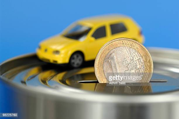 Toy car on money box, close-up