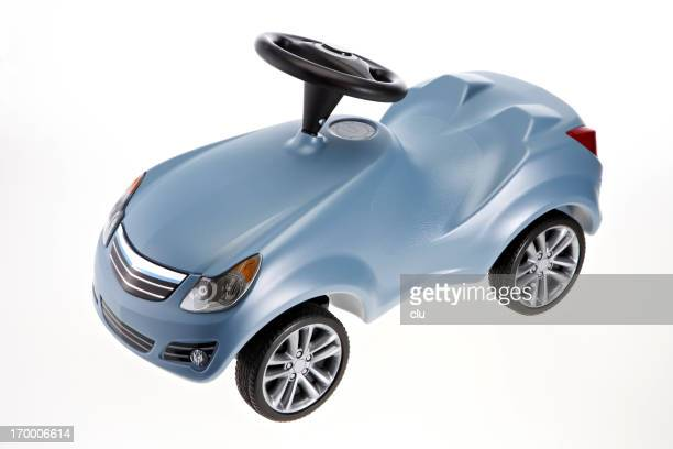 Toy car on white studio background