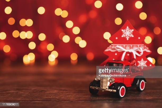 toy car with christmas tree - cartoon santa claus stock photos and pictures