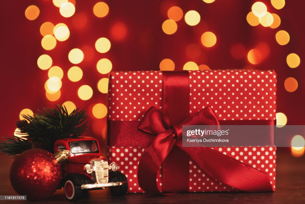 Toy car with Christmas tree : Stock Photo