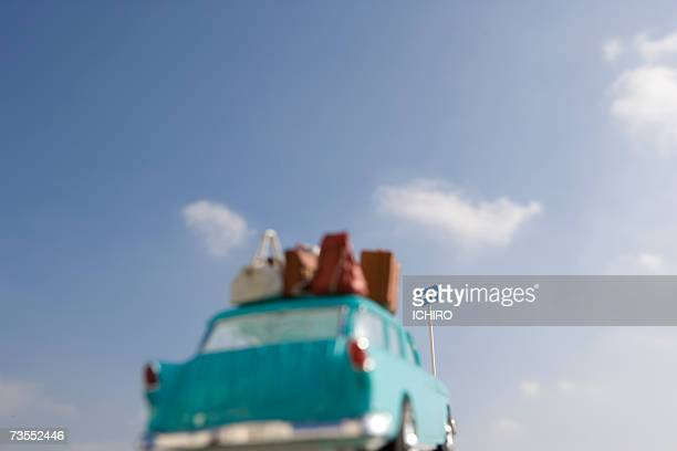 toy car with luggage on roof rack - luggage rack stock photos and pictures