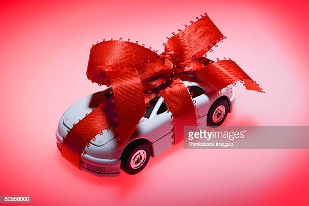 Toy car wrapped in ribbon
