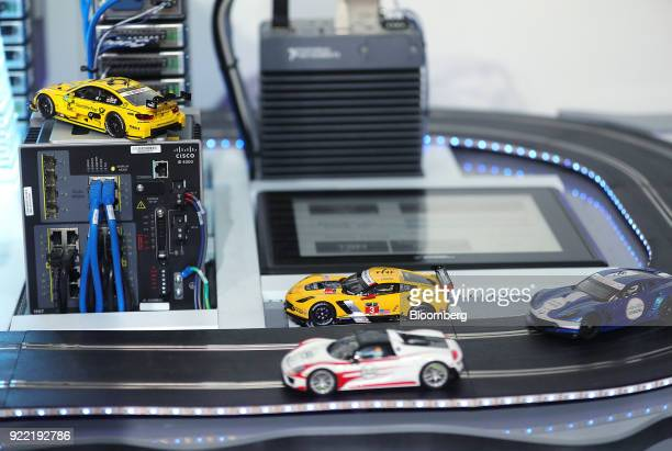 Toy cars drive on a track on the Cisco Technologies Inc exhibition stand during the Robert Bosch GmbH Internet of Things conference in Berlin Germany...
