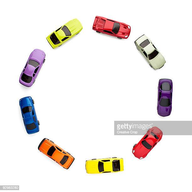 Toy cars forming a circle / roundabout