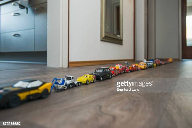 Toy cars standing in a row in apartment