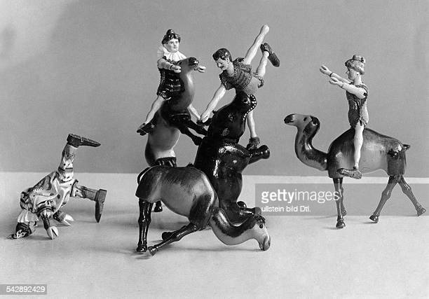 toy circus Humpty Dumpty acrobat dolls performing with camels and hippo date unknown around 1906