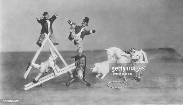 toy circus Humpty Dumpty clowns and femal acrobat performing date unknown around 1905